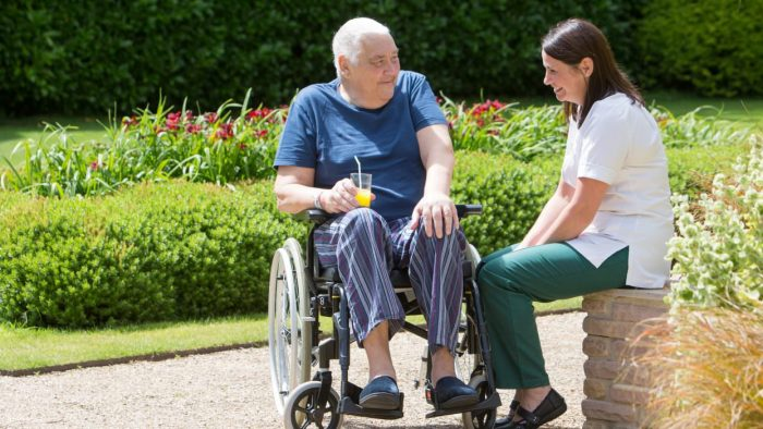 Rowcroft Hospice Occupational Therapist and Patient in Grounds chatting